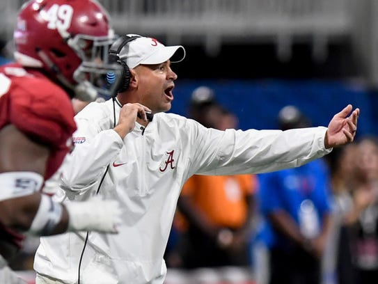 Alabama defensive coordinator Jeremy Pruitt, though he had been hired as Tennessee's head coach, stayed with the Crimson Tide during the playoffs and earned a hefty bonus. (Mickey Welsh / Montgomery Advertiser)