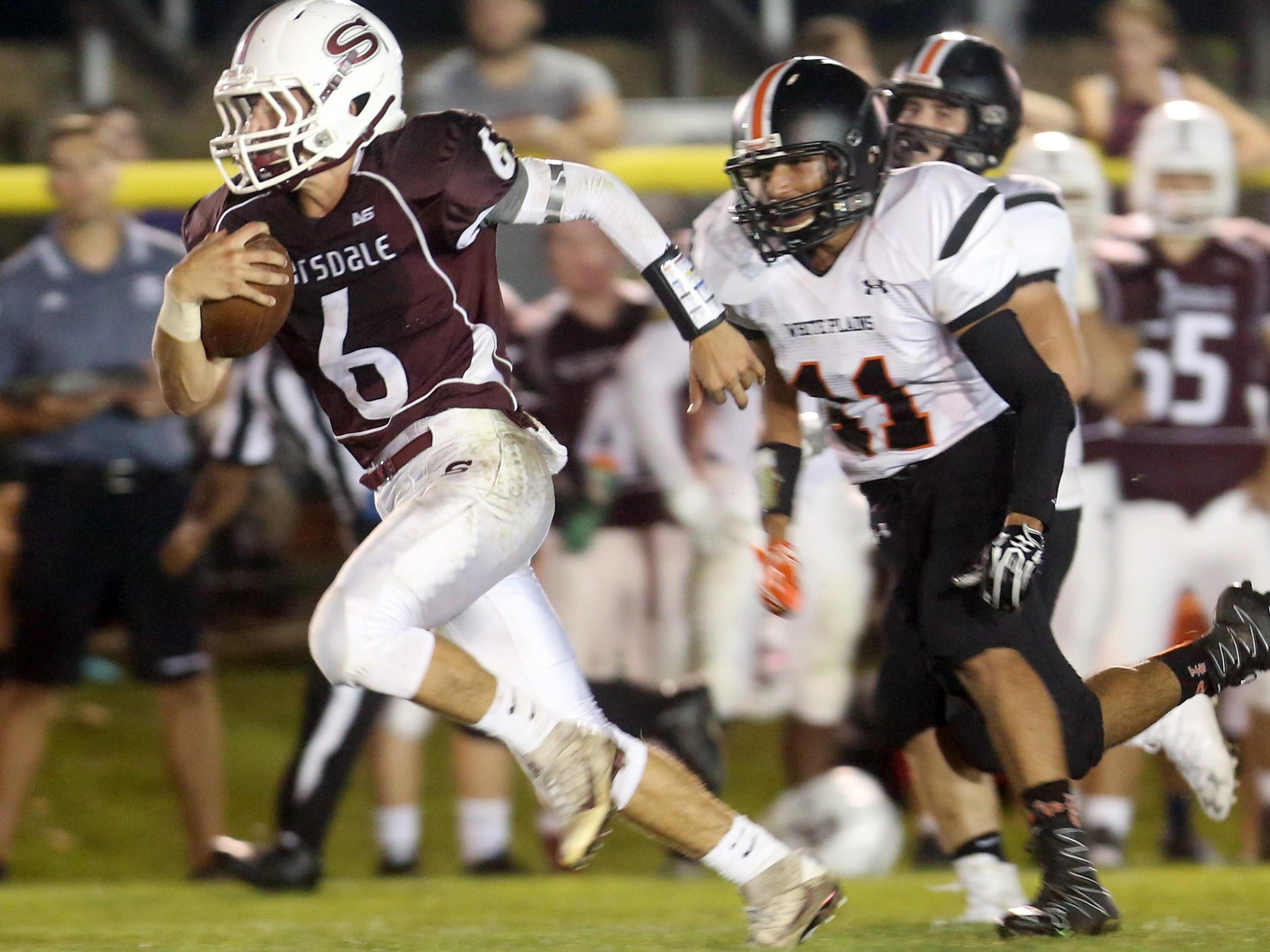 Scarsdale quarterback Barry Klein breaks free for a 40-yard touchdown run against White Plains during Friday night's game at Scarsdale High School.