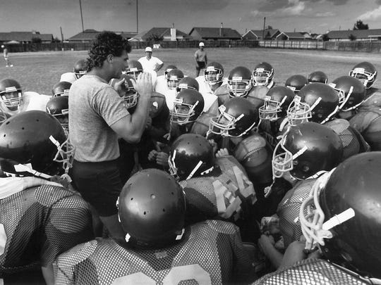 Wylie coach Hugh Sandifer talks to his team during a workout earlier in his career.