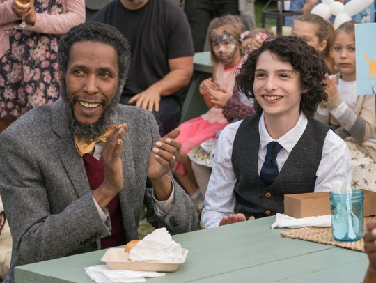 "Ron Cephas Jones (left) and Finn Wolfhard star in ""Dog"