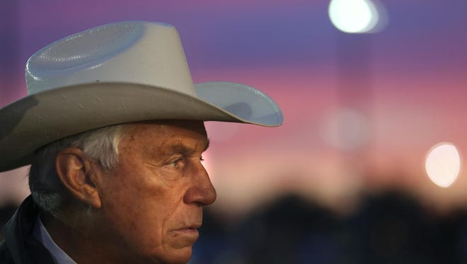 Trainer D. Wayne Lukas gets ready to do a television interview on the backside of Churchill Downs.May 2, 2013