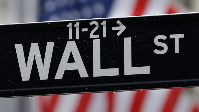 A Wall Street sign near the New York Stock Exchange.  (AP Photo/Seth Wenig, File)