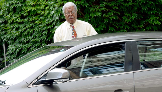 Former Ingham County Prosecutor Stuart Dunnings III gets into a car after a court hearing Tuesday, Aug. 2, 2016, in Judge Michael Klaeren's courtroom at the Jackson County Courthouse.