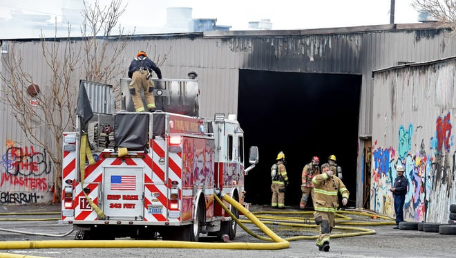 Sparks firefighters work to extinguish a fire at an abandoned building on Dermody Way in Sparks on Monday afternoon, April 16, 2018.