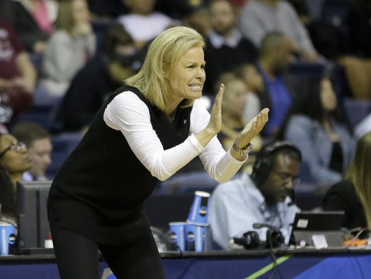 FSU head coach Sue Semrau claps after her team scored