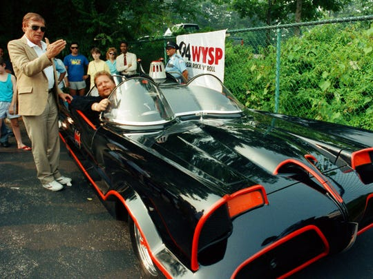 In this June 27, 1989 file photo, Adam West, left, stands beside the old Batmobile driven by owner Scott Chinery in Philadelphia.