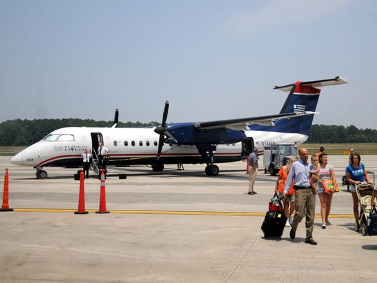 Travelers exit a plane at the Salisbury-Ocean City-Wicomico