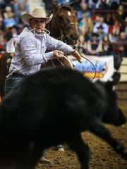 Michael Perry catches a calf for tie down during the 2018 San Angelo Stock Show & Rodeo.