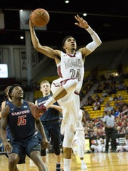 New Mexico State's Matt Taylor drives to the basket