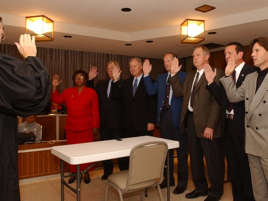 A judge swears in Rapides Parish School Board Members,