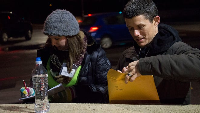 Community Bridges volunteers Julie Wonsowicz-Moore (left) and TJ Howard complete surveys during the Point-in-Time homeless count on Tuesday.