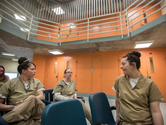 "Inmates in the recovery pod of the Hamilton County Justice Center talk about the importance of the program that was started last fall under the direction of Charmaine McGuffey, former commander of the Justice Center. The majority of the women in the program have opioid addiction. The program offers the women peer counseling, art and yoga and gives them an exit strategy for when they leave. A men's program should be starting later in May. Kimberly Knecht, 30, center, who will be getting out shortly said the peer mentors have taught them they can have their lives back. She said, ""I have been in the recovery pod almost six months and I can honestly say if it wasn't for this pod, when I leave, I probably would have just gone back to my old ways."""