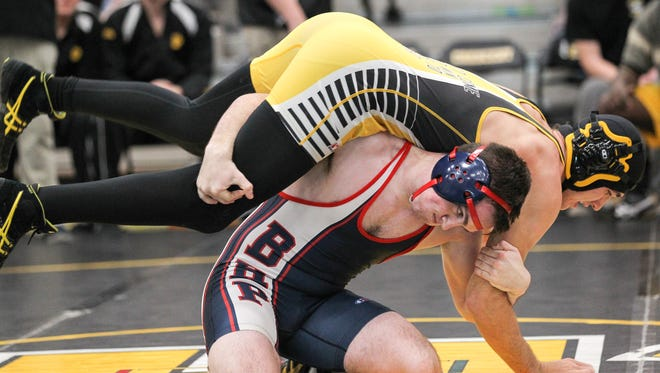 Dalton Barefoot of Belton-Honea Path wrestles with C.C. Spires of Crescent in the 170-pound class during a meet at Crescent High School in Iva. Barefoot won 7-2, and the Bears won 44-29.