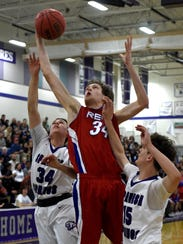 Reno's Tommy Challis goes up for a rebound against