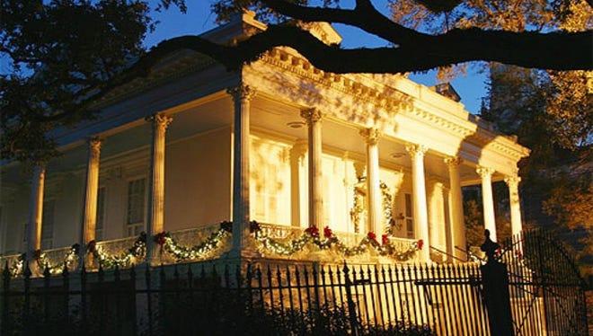 Corinthian columns surround a wraparound porch.