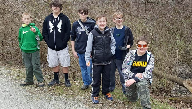 Boy Scout Troop 103 of St. Joseph Parish in Hanover members involved in the geocaching adventure along the Hanover Trolley Trail, from left, are Matthew Nawn (holding the cache), Justin Henninger, Brody Goulden, Ethan Martin, Kaleb Rigler and Ryan Small.