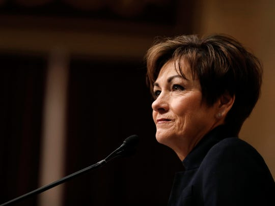 In this Jan. 9, 2018 file photo, Iowa Gov. Kim Reynolds delivers her Condition of the State address before a joint session of the Iowa Legislature at the Statehouse in Des Moines, Iowa.  Eight states cast midterm primary ballots Tuesday, with implications for control of the House, Senate and several governor's races.  (AP Photo/Charlie Neibergall)