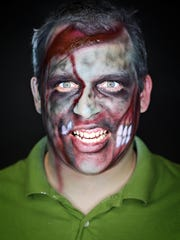 Jon Eddins, 33, models zombie makeup in the studio.