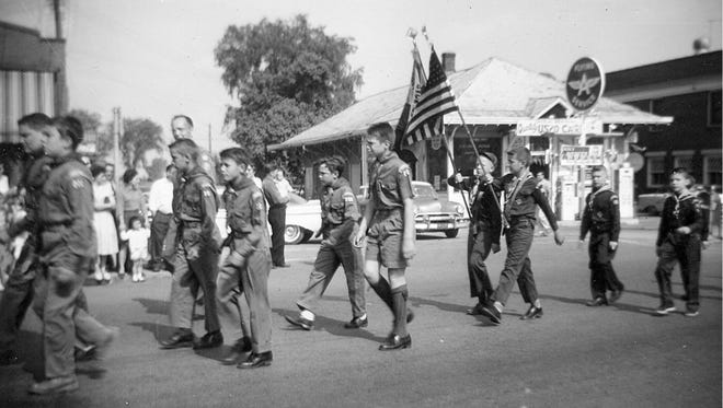 Boy Scouts parade in front of the trolley station (circa 1950s).