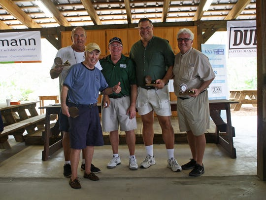 Third place at the VNA Charity Sporting Clay Shoot went to the Treasure Coast Hospice team of Will Gallagher, left, Peter Maglione, Greg Wheeler, Murray Fournie and Tony Comorat.