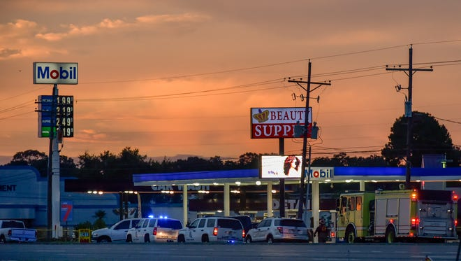 Baton Rouge Police investigate scene near Hammond Aire Shopping Center where three police oficers were killed today.  July, 17, 2016.