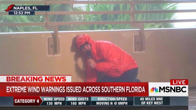 This image taken from video shows MSNBC's Kerry Sanders reporting on Hurricane Irma in Naples. Fla., on Sunday, Sept. 10, 2017. Journalists were the shock troops allowing the nation to experience the storm from the comfort of their living rooms. Networks all brought their top teams in on the weekend for special coverage, non-stop on the news channels. (MSNBC via AP)