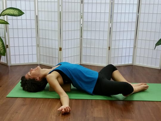 Reclined bolster for meditation shown by Aja Reeser at Yoga Bird, Fort Myers.