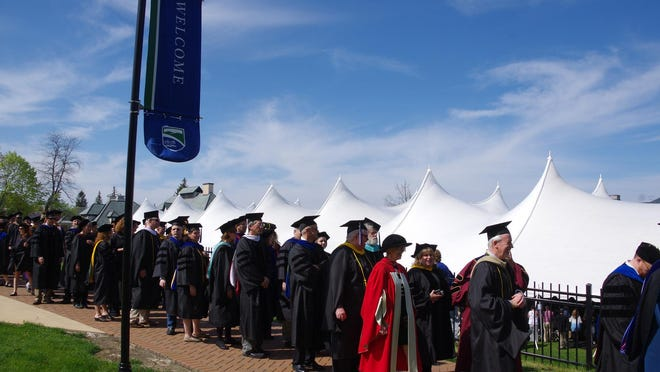 Faculty members and graduation in a procession at the Champlain College commencement.
