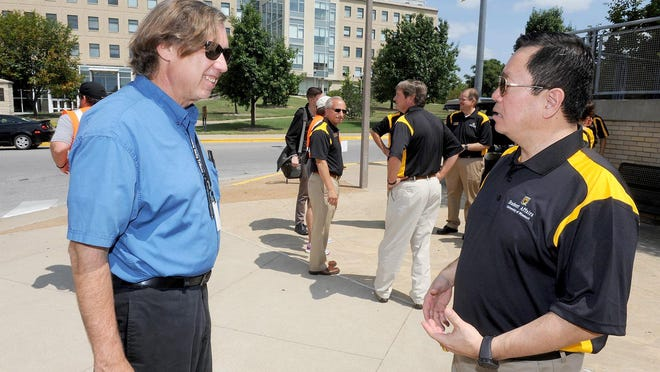 Rudi Keller, left, talks with MU System President Mun Choi during moving-in day at Ole Mizzou in August 2017.