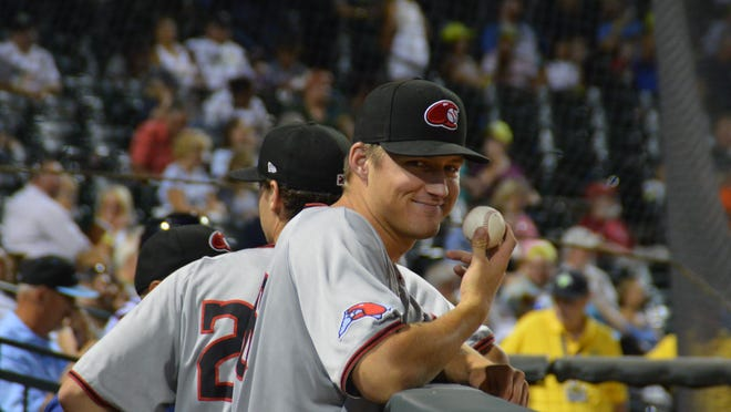 Grant Wolfram reacts during a game for the Hickory Crawdads last season.