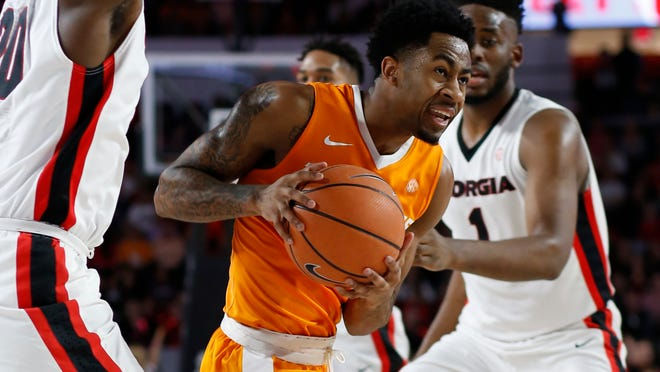Tennessee guard Jordan Bowden (23) looks for an open shot during the first half against Georgia on Saturday.