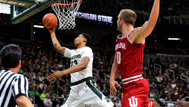 Spartans forward Deyonta Davis (23) goes up and under the hoop for a score  in the second half against Indiana Sunday, Feb. 14, 2016 in the Breslin Center in East Lansing.Davis finished with four points and four blocks in the 88-69 victory.