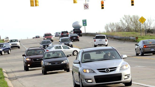 Busy traffic on Okemos Road in 2013.