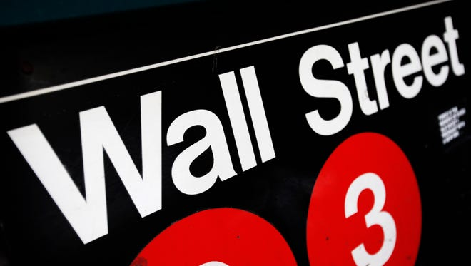 This Jan. 4, 2010, file photo shows an entrance to a Wall Street subway station in New York.