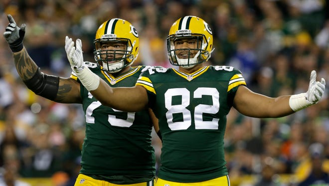 Green Bay Packers offensive lineman Josh Walker and tight end Richard Rodgers look to the officiating crew for an offsides call against the Seattle Seahawks after a Packers field goal during Sunday night's game at Lambeau Field.