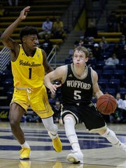 Wofford's Storm Murphy, right, drives the ball against California's Darius McNeill, left, during the second half of an NCAA college basketball game Thursday, Nov. 16, 2017, in Berkeley, Calif. (AP Photo/Ben Margot)