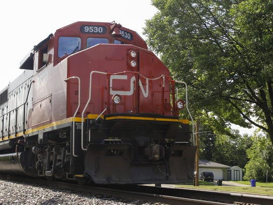 A Canadian National engine idles on the railroad tracks beside East Randall Avenue in Appleton.