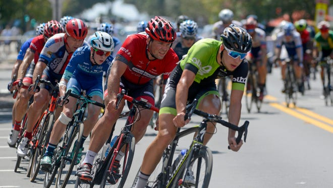 Racers make their way along the course during the Men's Pro 1/2 race of the Subway Pensacola Cycling Classic Sunday, September 17, 2017 in downtown Pensacola.
