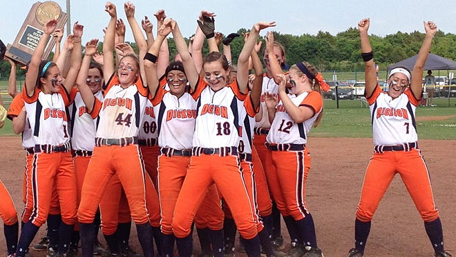 The Dickson County High School Lady Cougars softball team celebrates after winning the state Class AAA title Friday.