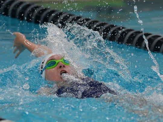 Pittsford's Megan Deuel swims the 100-yard backstroke.