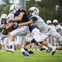 Port Washington's Michael Murphy tackles New Berlin West's Tyler Stoltenburg in action from earlier this season. The Pirates fell to Kewaskum, 21-14, on Aug. 26.