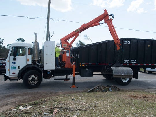 Emerald Coast Utilities Authority and other sanitation crews work tirelessly to cleanup and remove debris from the Northeast Pensacola area struck by last week's tornado.