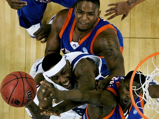 March 21, 2008 - Memphis' Robert Dozier, bottom left, battles a group of UT-Arlington defenders while driving to the basket during first half action of their first round NCAA tournament game in Little Rock.