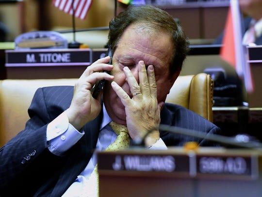 Assemblymen Tom Abinanti, D-Greenburgh rubs his eyes