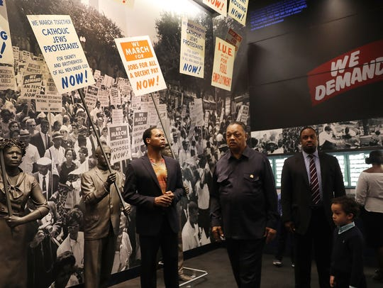 The Rev. Jesse Jackson tours the National Civil Rights Museum with his family as the city prepares for the 50th anniversary of the assassination of Martin Luther King Jr.