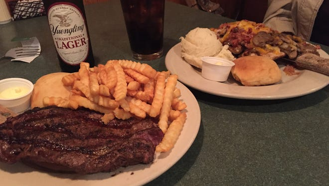 Creekside Lodge in Crawfordsville offers a wide variety of menu choices. Here is the ribeye steak and smothered chicken.
