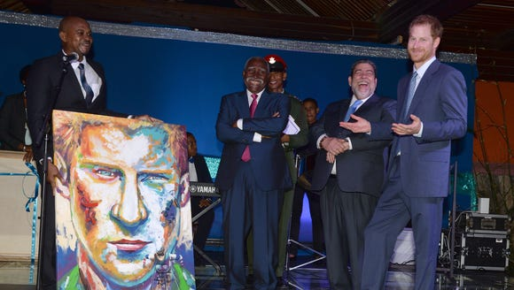 Prince Harry receives a picture of himself in Colonarie,