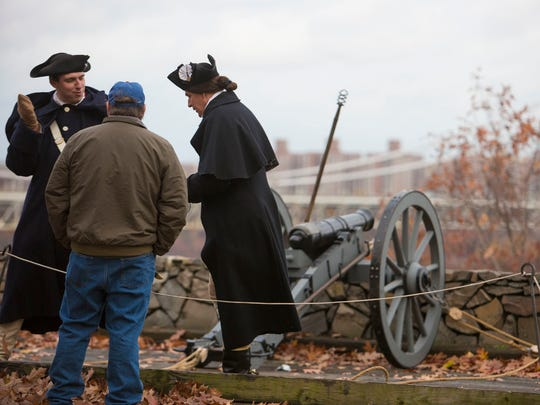 Chad Johnson, left and Mike McGurty, right act as members of the colonial 2nd artillery during a firearms demonstration on Nov. 20, 2016 as part of reenactments commemorating the 240th Anniversary of the British Invasion of New Jersey.