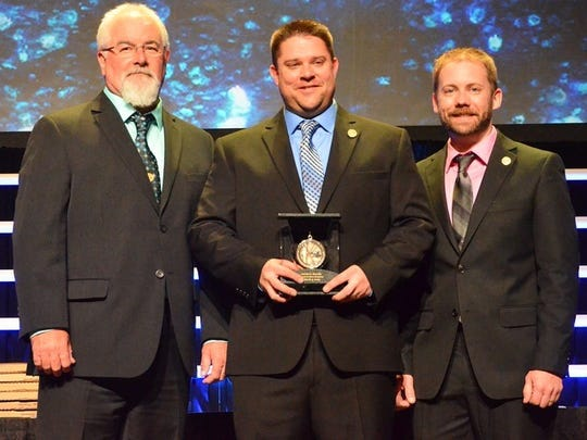 Green Bay air traffic Controllers Mike Ostrander, Justin Krenke and Adam Helm were honored on Mar 4, 2015, in Las Vegas, for their actions in saving a pilot in distress on Feb. 13, 2014.