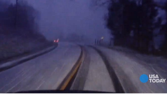 A dashboard camera captures lightning and thunder during a snowstorm, which is called thundersnow.